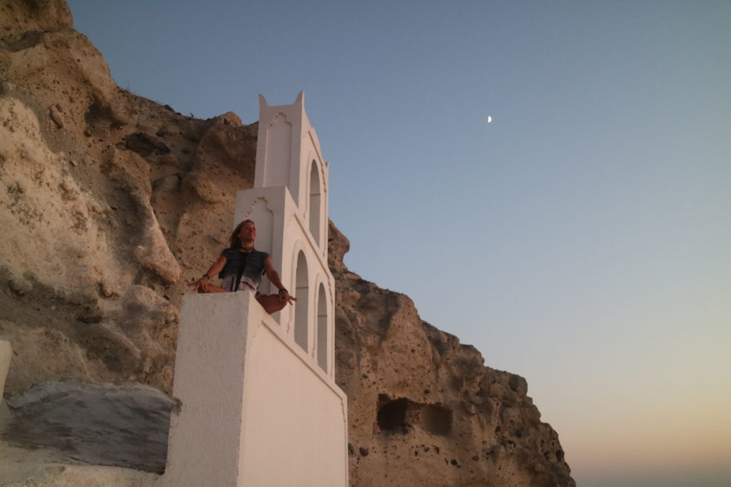 Jewels Bertrand Meditating in at the hidden cliffside church Santorini Greece